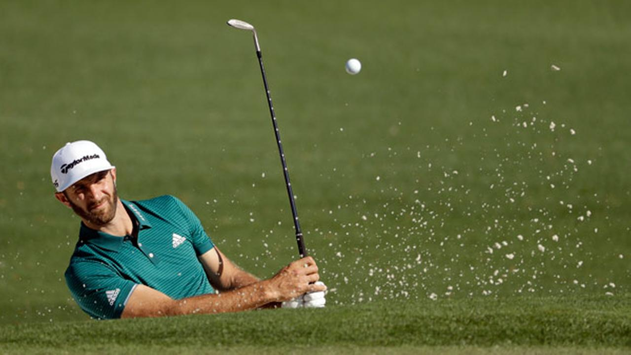 Dustin Johnson hits out of a bunker on the second hole during a practice round for the Masters golf tournament Tuesday, April 4, 2017, in Augusta, Ga.