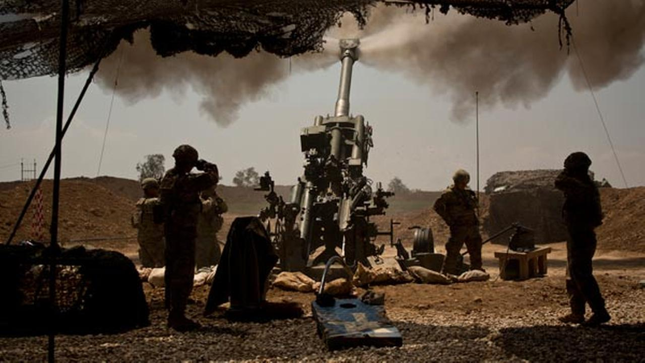 FILE - In this April 17, 2017 file photo, U.S. soldiers from the 82nd Airborne Division fire artillery in support of Iraqi forces fighting Islamic State militants.