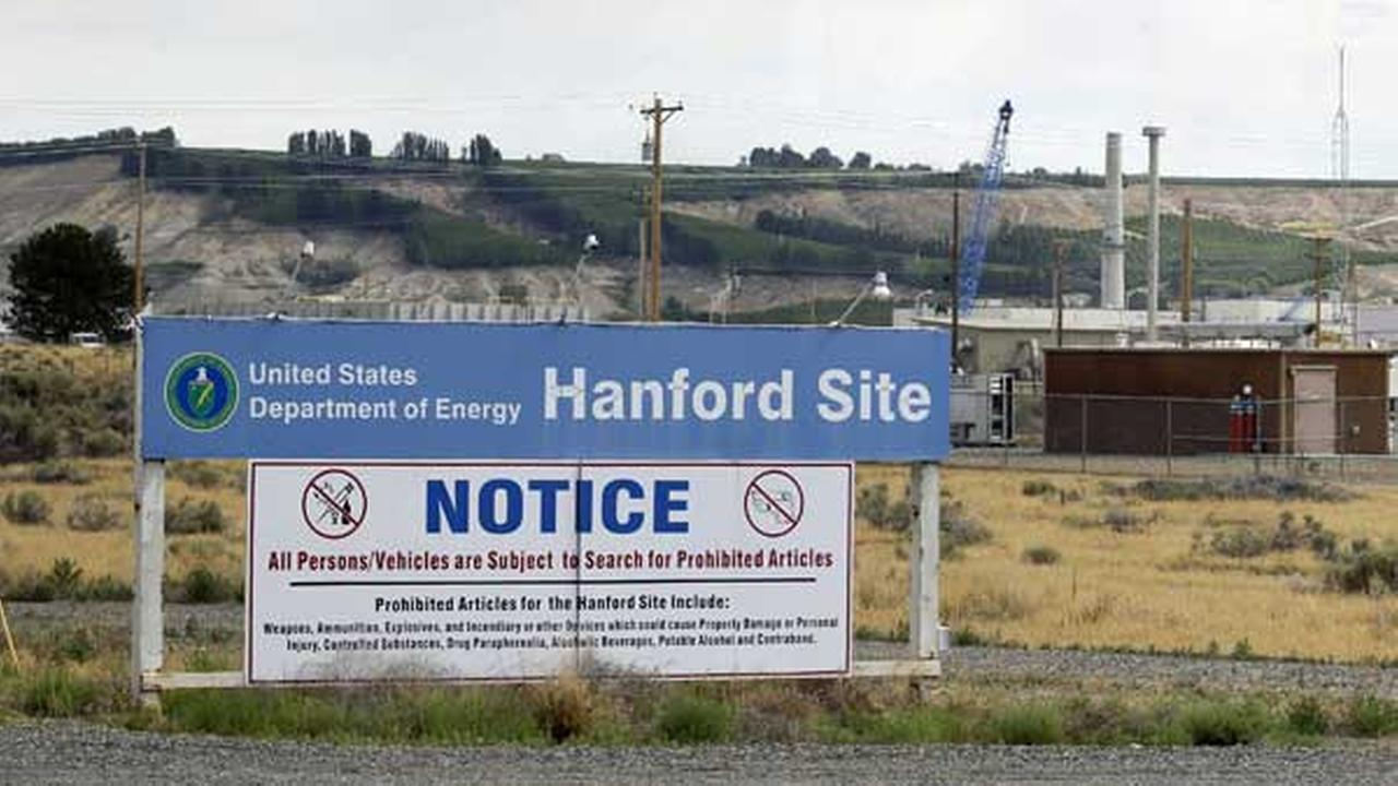 FILE - In this July 9, 2014 file photo, a sign informs visitors of prohibited items on the Hanford Nuclear Reservation near Richland, Wash.