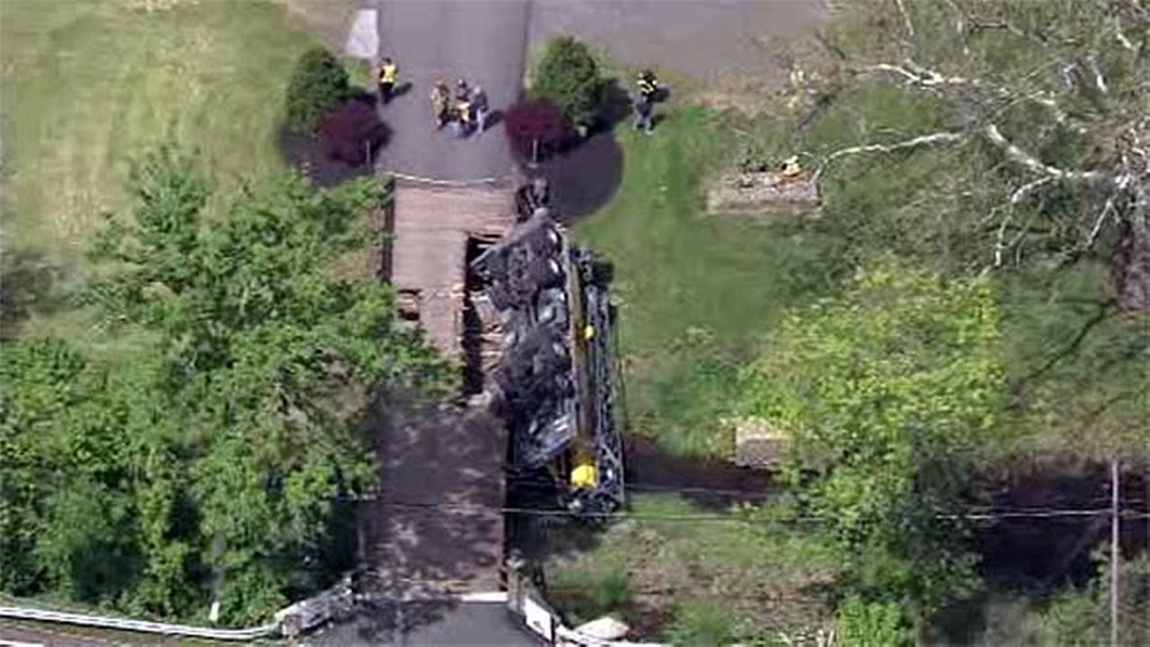 Truck rolls off wooden bridge in Lower Pottsgrove, Pa.