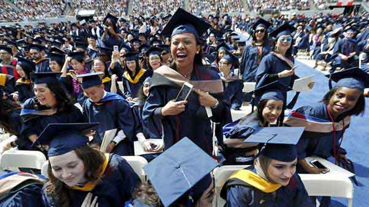 Graduates react as musician Bon Jovi is introduced on the stage for a surprise performance during the Fairleigh Dickinson University commencement ceremony at MetLife Stadium.