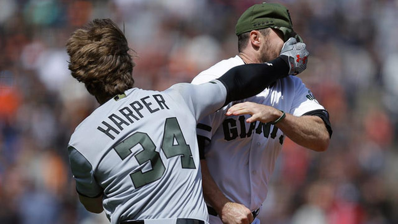 Washington Nationals Bryce Harper (34) hits San Francisco Giants Hunter Strickland in the face after being hit with a pitch in the eighth inning of a baseball game.