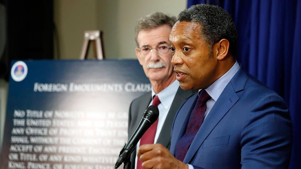 District of Columbia Attorney General Karl Racine, right, accompanied by Maryland Attorney General Brian Frosh, speaks during a news conference in Washington, Monday, June 12, 2017