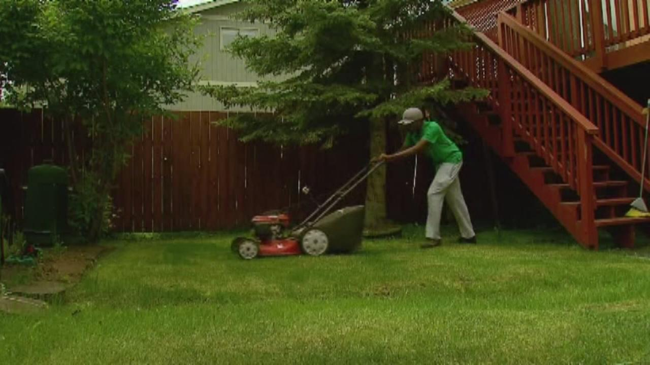 Teen mows lawns for a good reason
