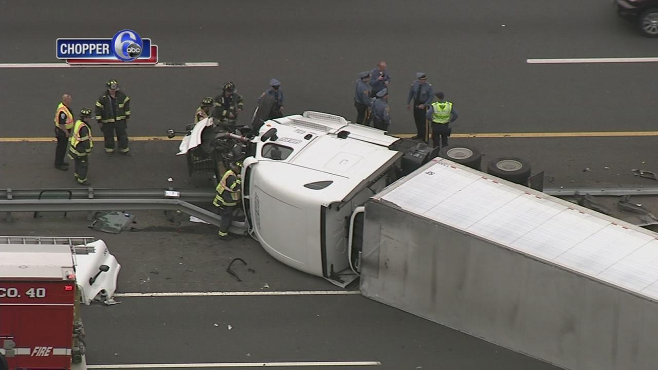 Driver rescued after tractor-trailer overturns on NJ Turnpike