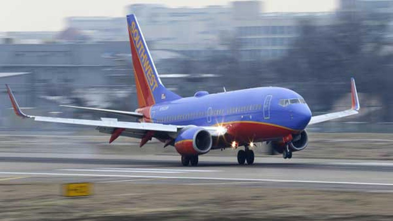 File - In this Feb. 3, 2014 file photo, a Southwest Airlines jet plane lands at Love Field in Dallas.