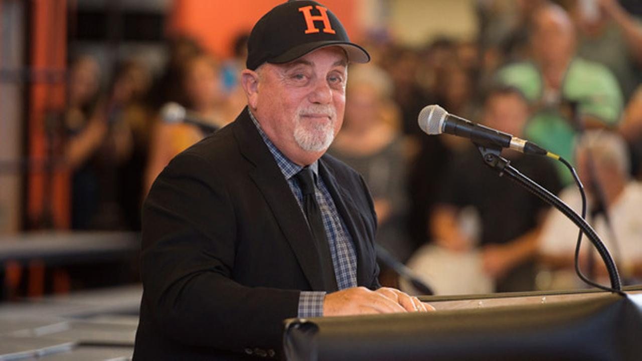 Musician Billy Joel speaks at the Hicksville High School 2017 graduation ceremony in the schools gymnasium, on Saturday, June 24, 2017, in Hicksville, New York.