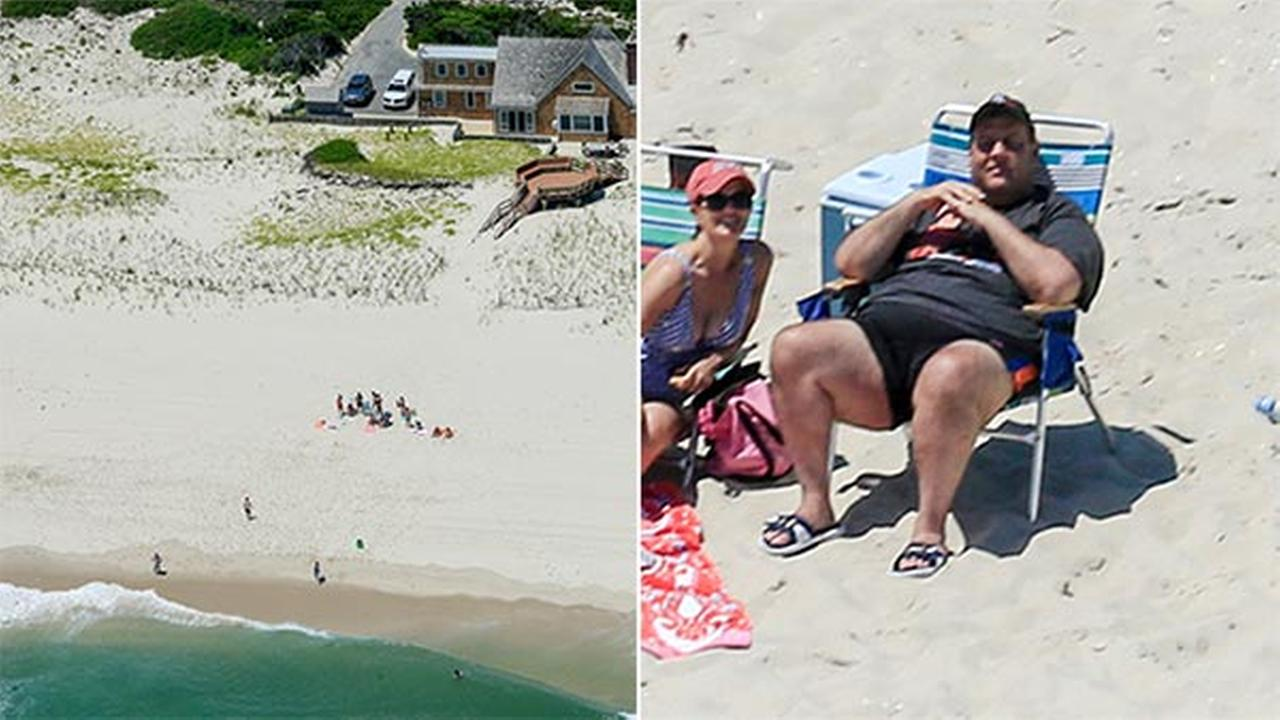 In this Sunday, July 2, 2017, photo, N.J. Gov. Chris Christie, right, uses the beach with his family and friends at the governors summer house at Island Beach State Park.
