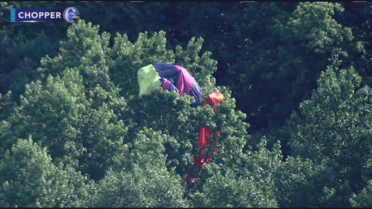 Skydiver gets stuck in tree in Monroe Twp, N.J.