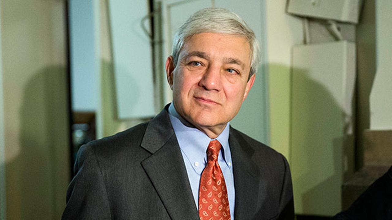 Former Penn State president Graham Spanier walks from a hearing before a Superior Court panel at City Hall Wednesday, May 21, 2014, in Philadelphia.