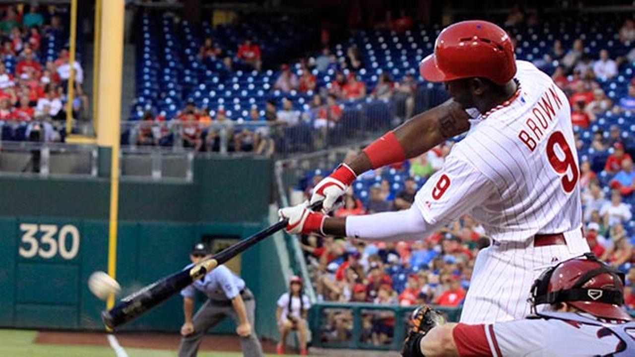 Philadelphia Phillies Domonic Brown (9) hits a double against the Arizona Diamondbacks in the third inning of a baseball game on Friday, July 25, 2014, in Philadelphia.