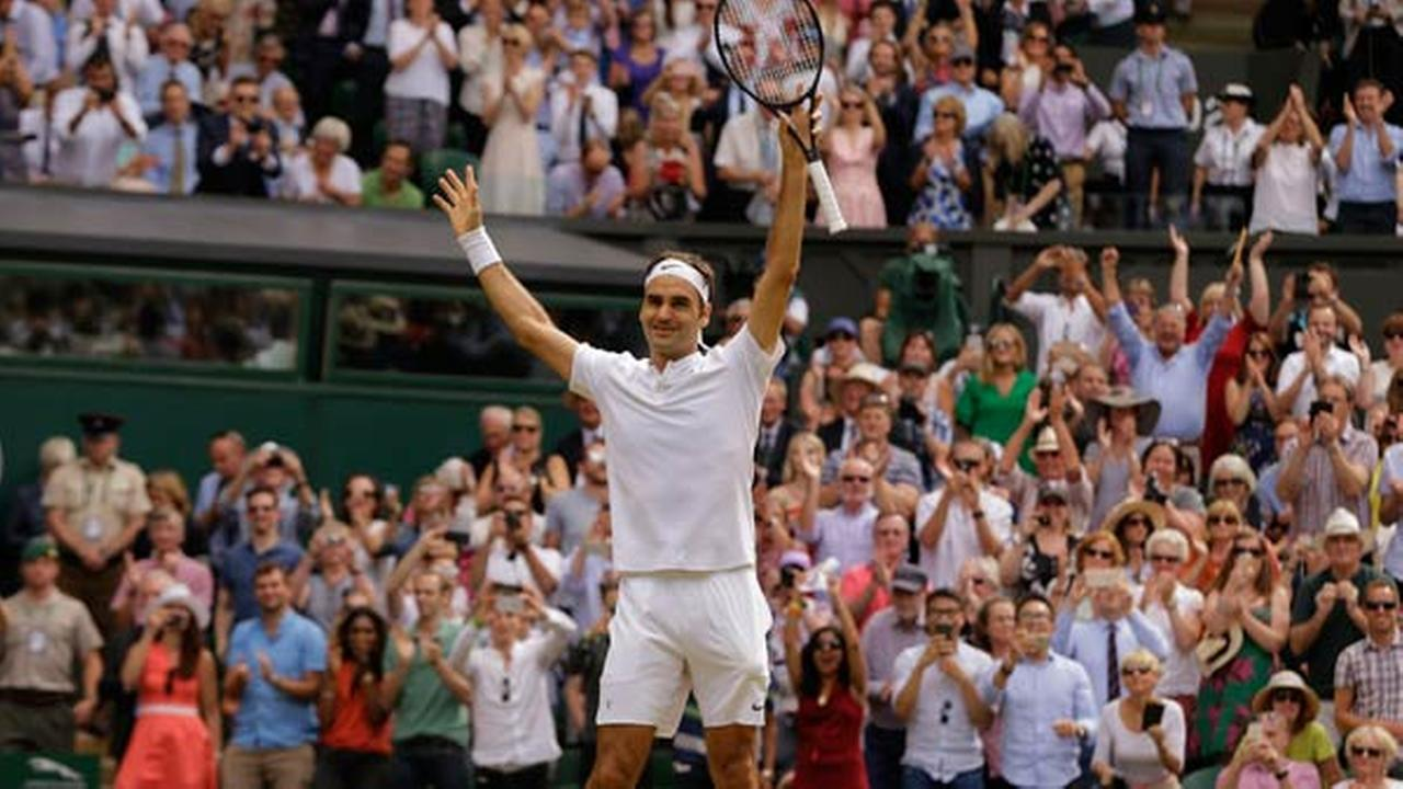 Switzerlands Roger Federer celebrates after defeating Croatias Marin Cilic to win the Mens Singles final match.