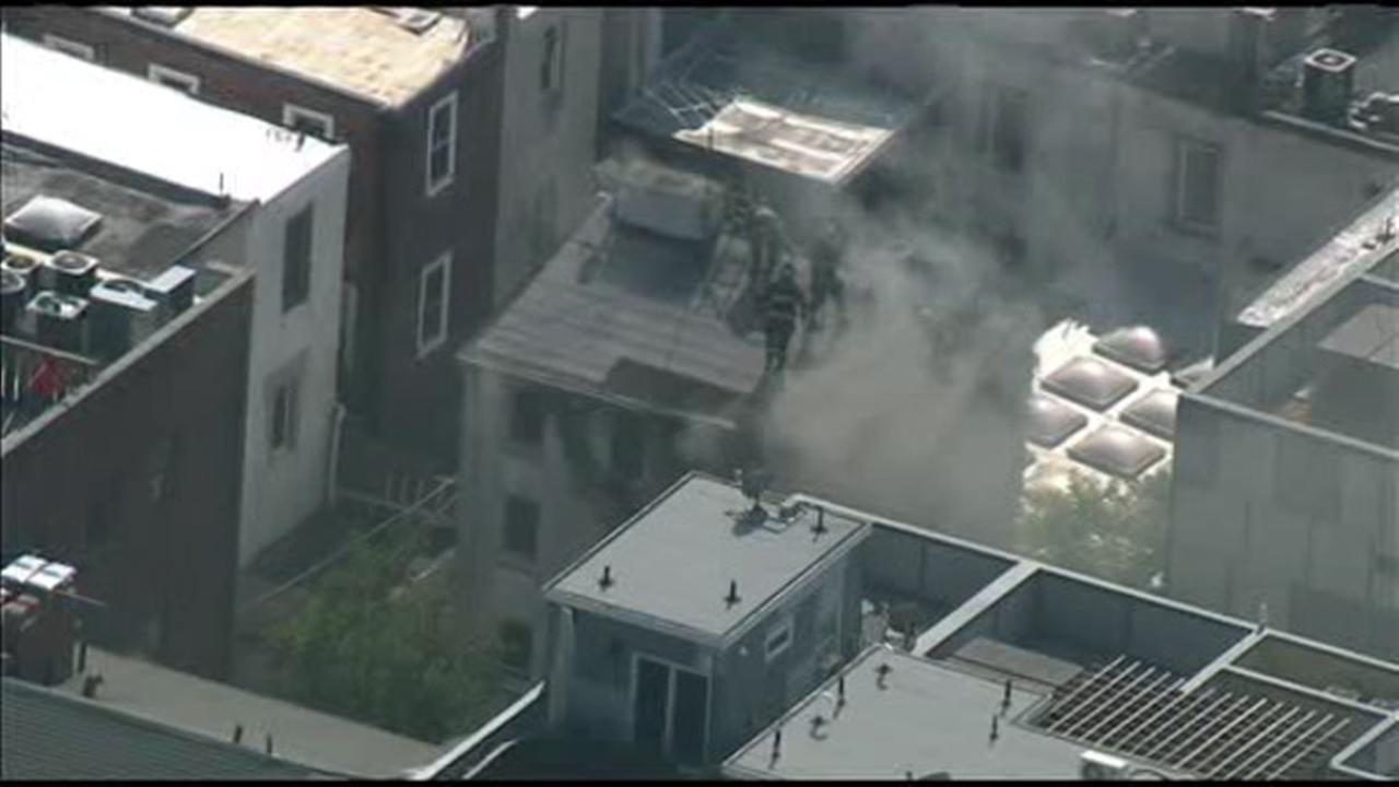 Firefighters battle Washington Square fire