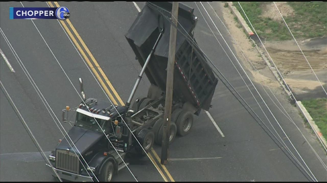 Dump truck hits wires
