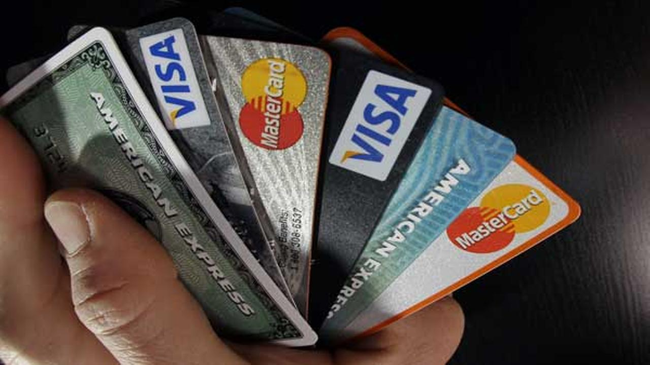 In this March 5, 2012 photo, consumer credit cards are posed in North Andover, Mass.