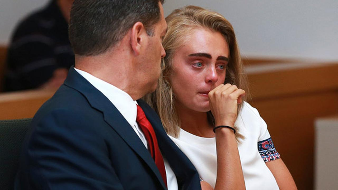 Michelle Carter awaits her sentencing in a courtoom in Taunton, Mass., Thursday, Aug. 3, 2017, for involuntary manslaughter for encouraging Conrad Roy III to kill himself.