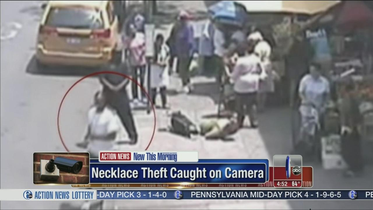 VIDEO: Thief rips necklace from woman, caught on camera