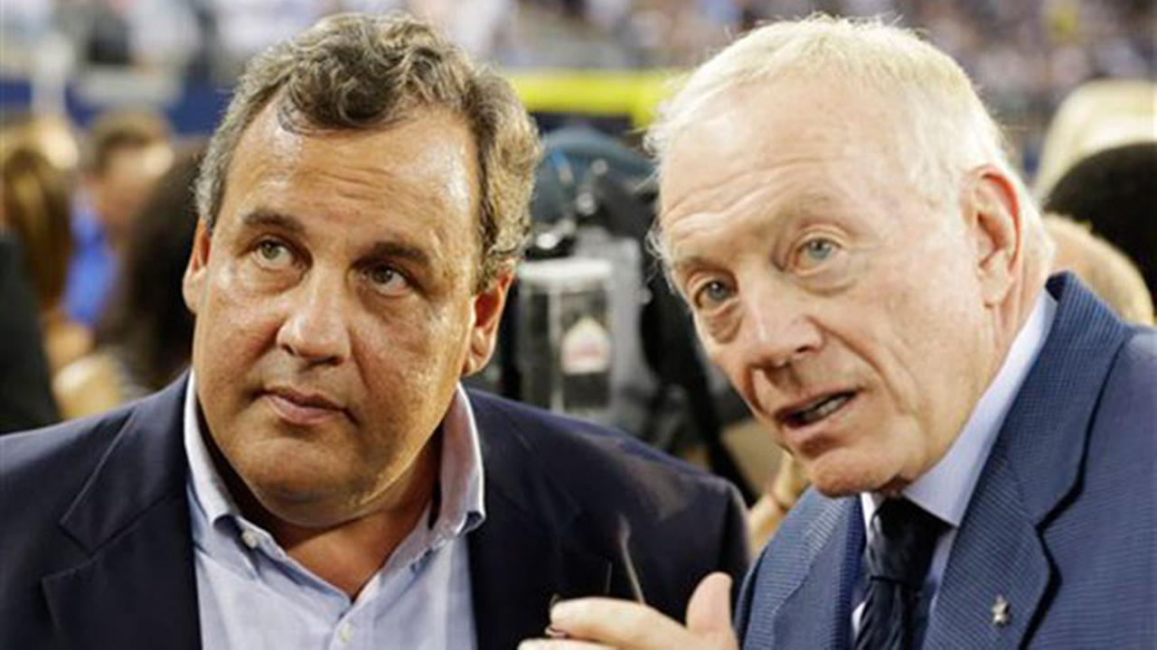New Jersey Governor Chris Christie, left and Dallas Cowboys owner Jerry Jones talk before a NFL football game against the New York Giants Sunday, Sept. 8, 2013, in Arlington, Texas