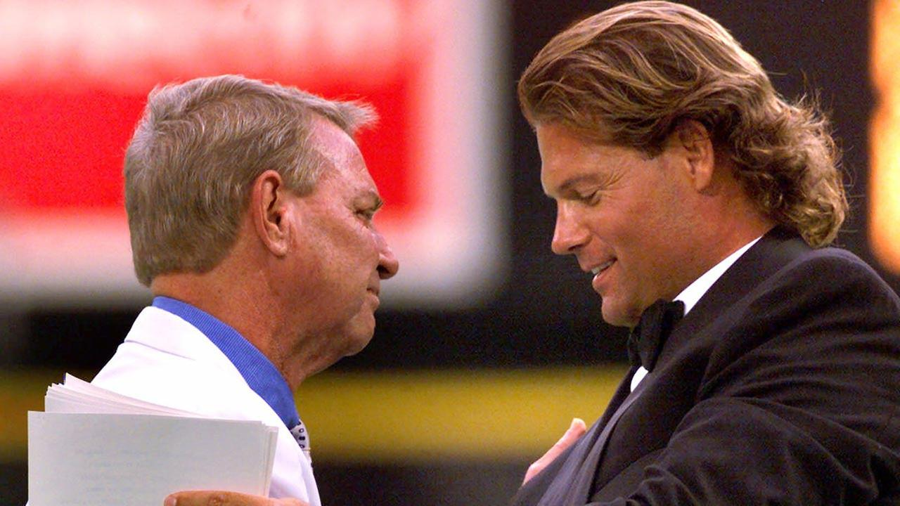 Harry Kalas is greeted by Darren Daulton during a ceremony honoring Kalas 30 season as a Phillies broadcaster on July 29, 2000. (AP Photo/Rusty Kennedy)