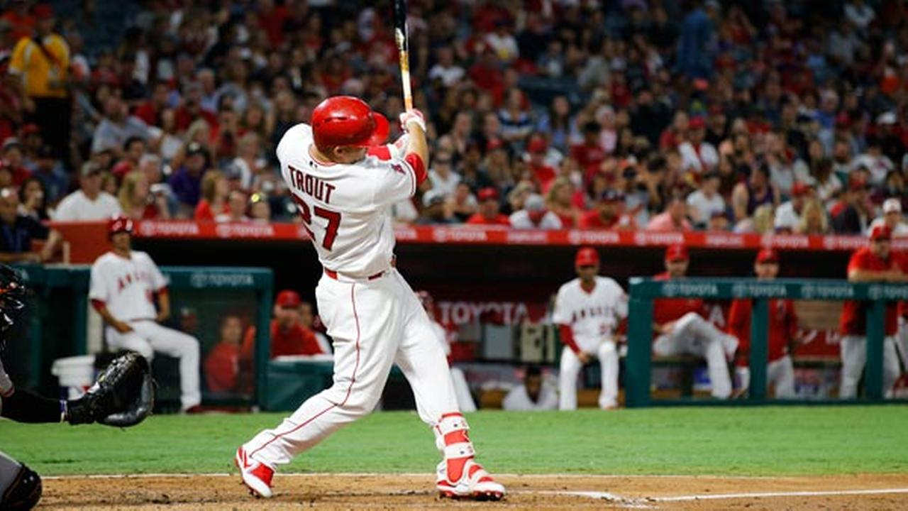 Los Angeles Angels Mike Trout hits a double, the 1000th hit of his career, during the fourth inning of a baseball game against the Baltimore Orioles, Monday, Aug. 7, 2017, in Anah