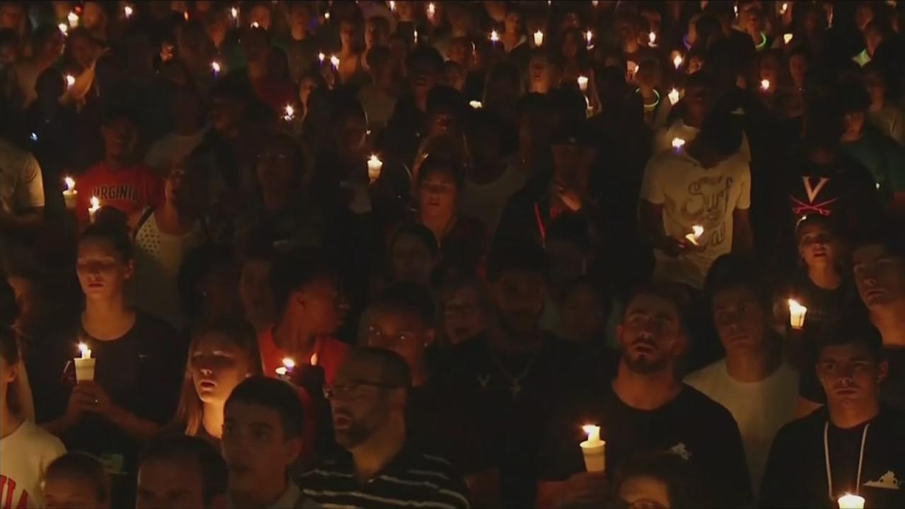 Peaceful candlelight vigil moves through UVA campus