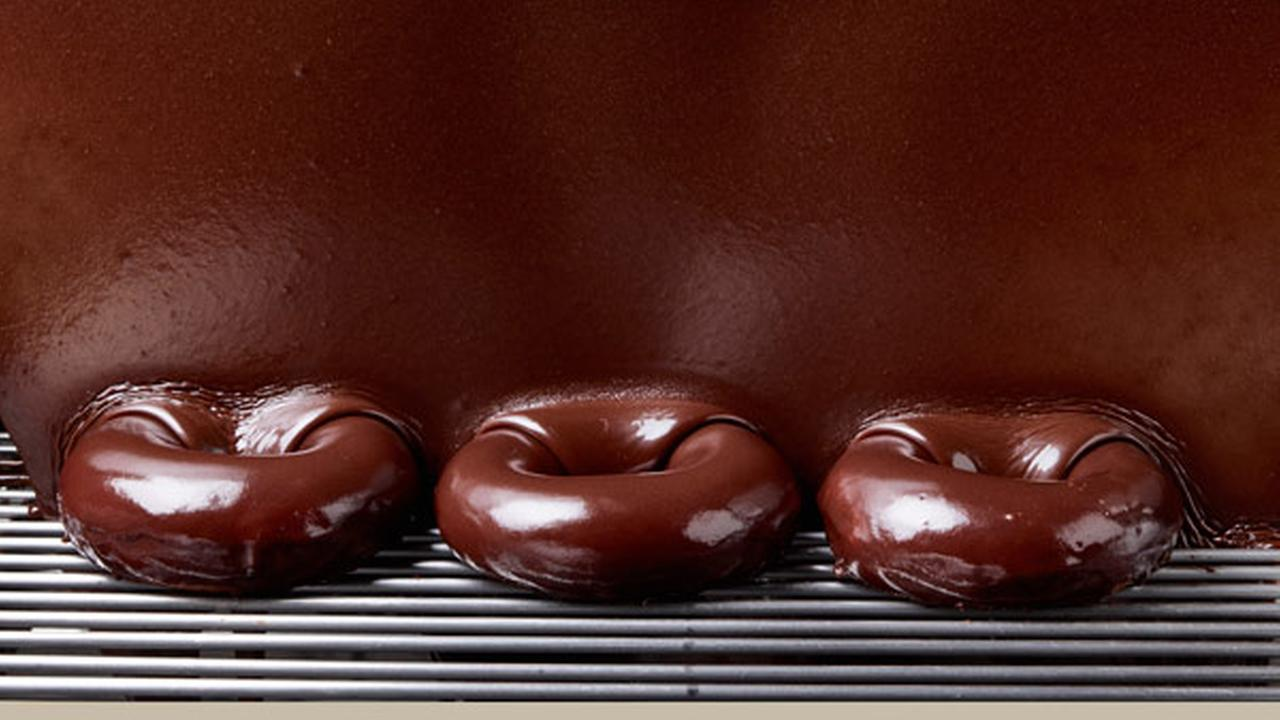 This undated product image provided by Krispy Kreme shows its signature glazed doughnut with a chocolate sheen.