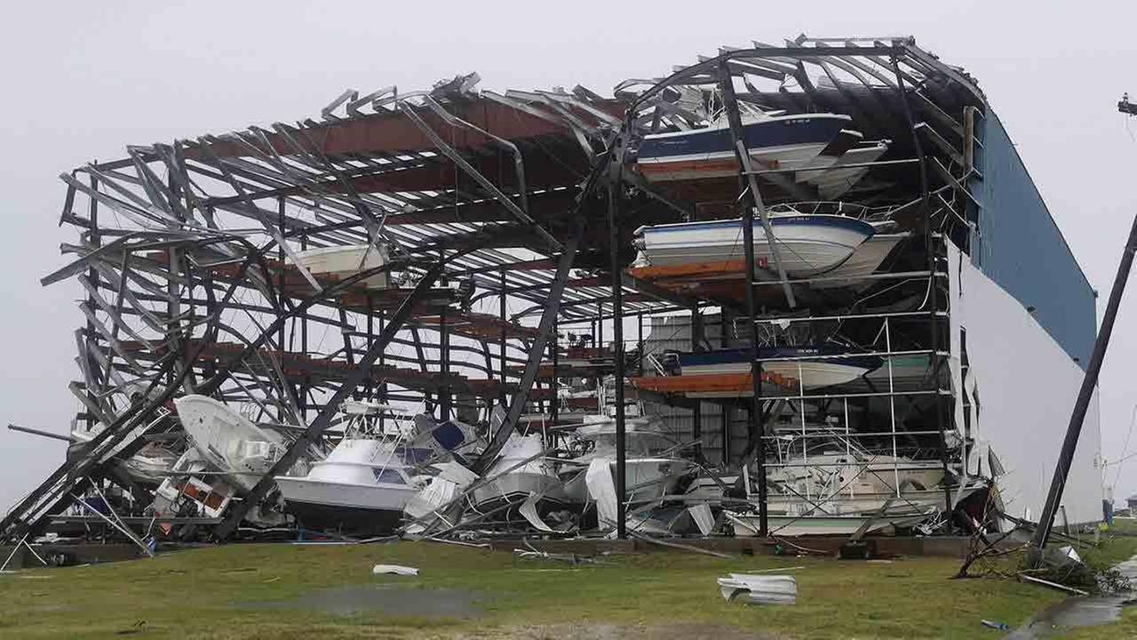 Toppled boats hang in the debris of a boat storage facility that was damaged by Hurricane Harvey, Saturday, Aug. 26, 2017, in Rockport, Texas.