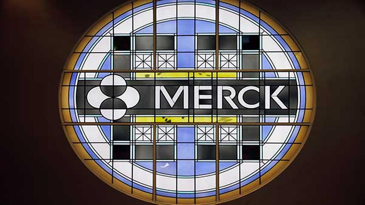 FILE - This Thursday, Dec.18, 2014, file photograph, shows the Merck logo on a stained glass panel at a Merck company building in Kenilworth, N.J.