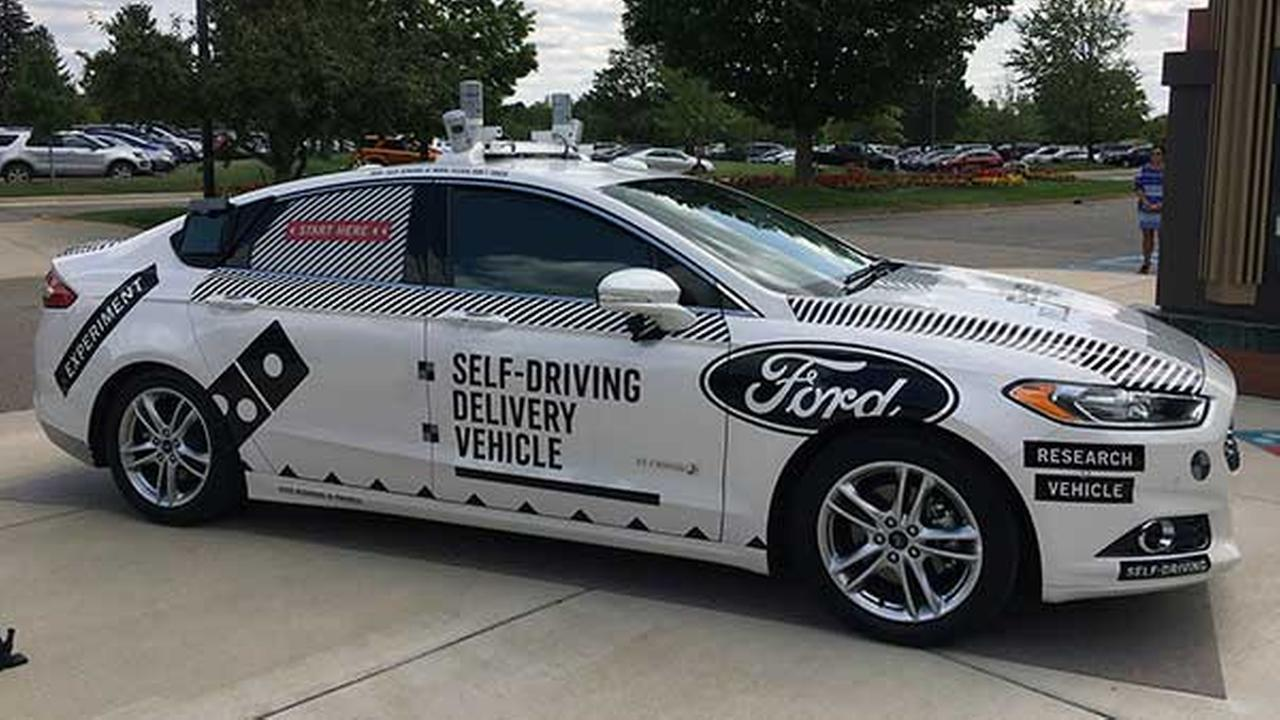 This Friday, Aug. 24, photo, shows the specially designed delivery car that Ford Motor Co. and Dominos Pizza will use to test self-driving pizza deliveries.
