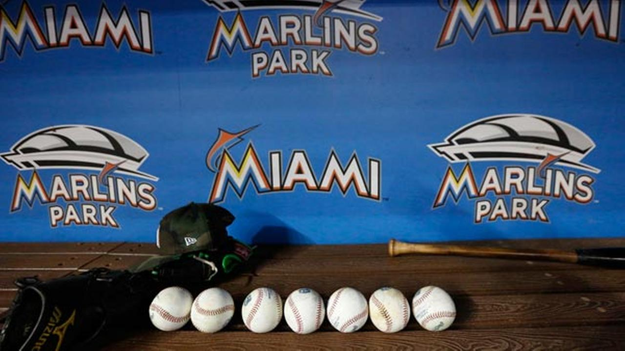 Balls and equipment are shown in the Miami Marlins dugout before the start of a baseball game against the Philadelphia Phillies, Saturday, Sept. 2, 2017, in Miami.