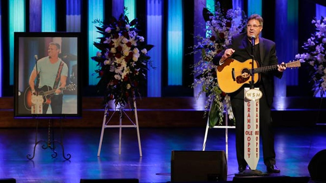 Vince Gill speaks during a memorial service for country music singer Troy Gentry at the Grand Ole Opry House Thursday, Sept. 14, 2017, in Nashville, Tenn.