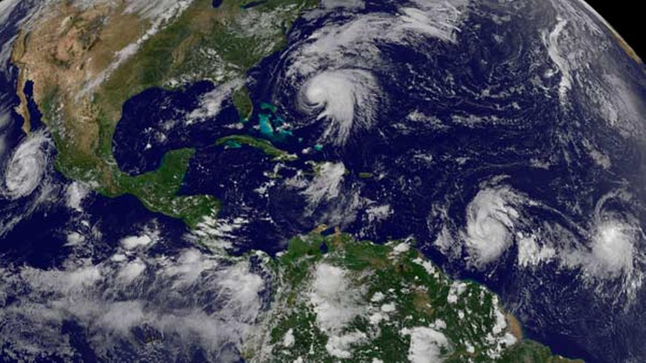 This image made available by the NOAA-NASA GOES Project shows tropical weather systems Hurricane Norma, left, on the Pacific Ocean side of Mexico; Jose, center, east of Florida;