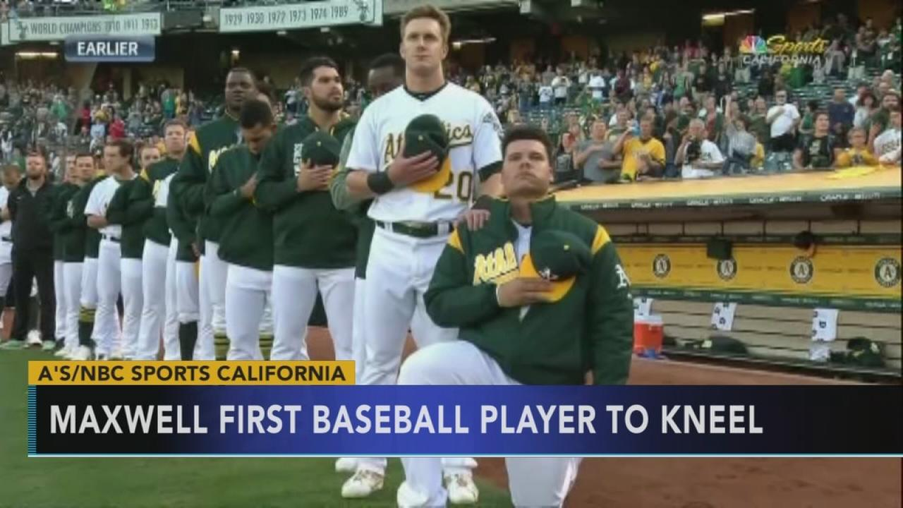As catcher Bruce Maxwell kneels during national anthem