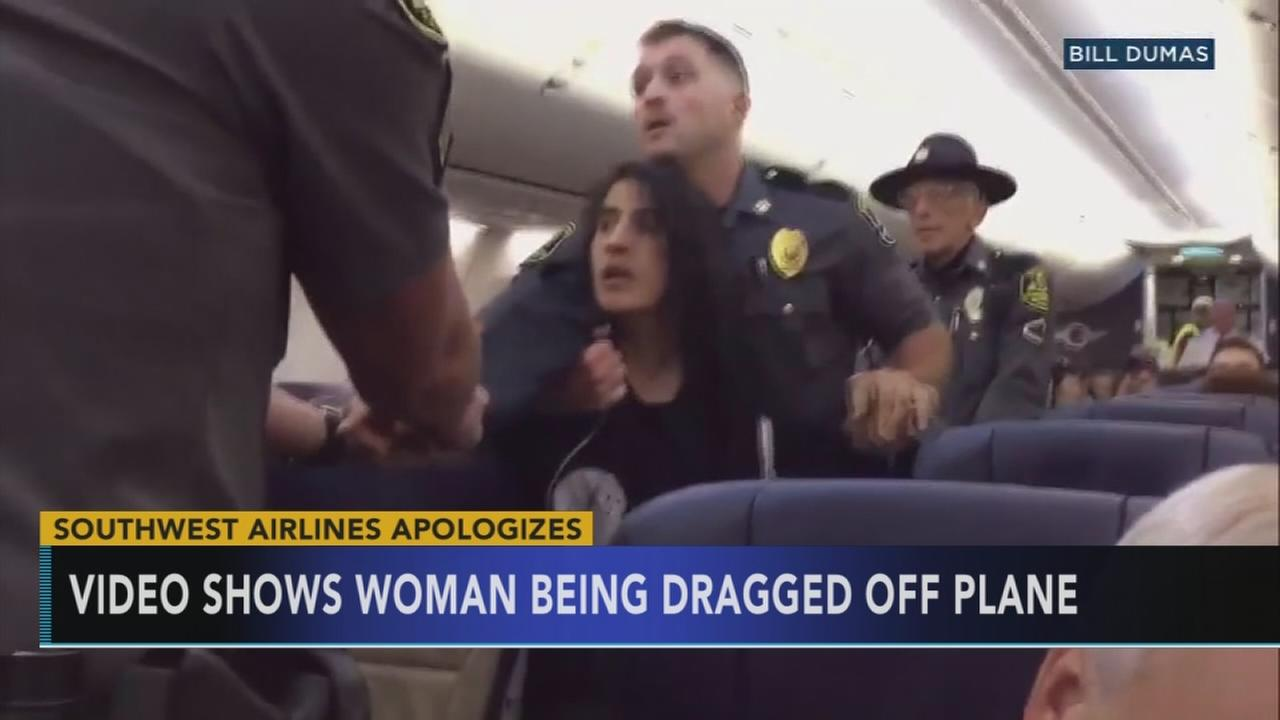 Police drag woman off Southwest Airlines flight