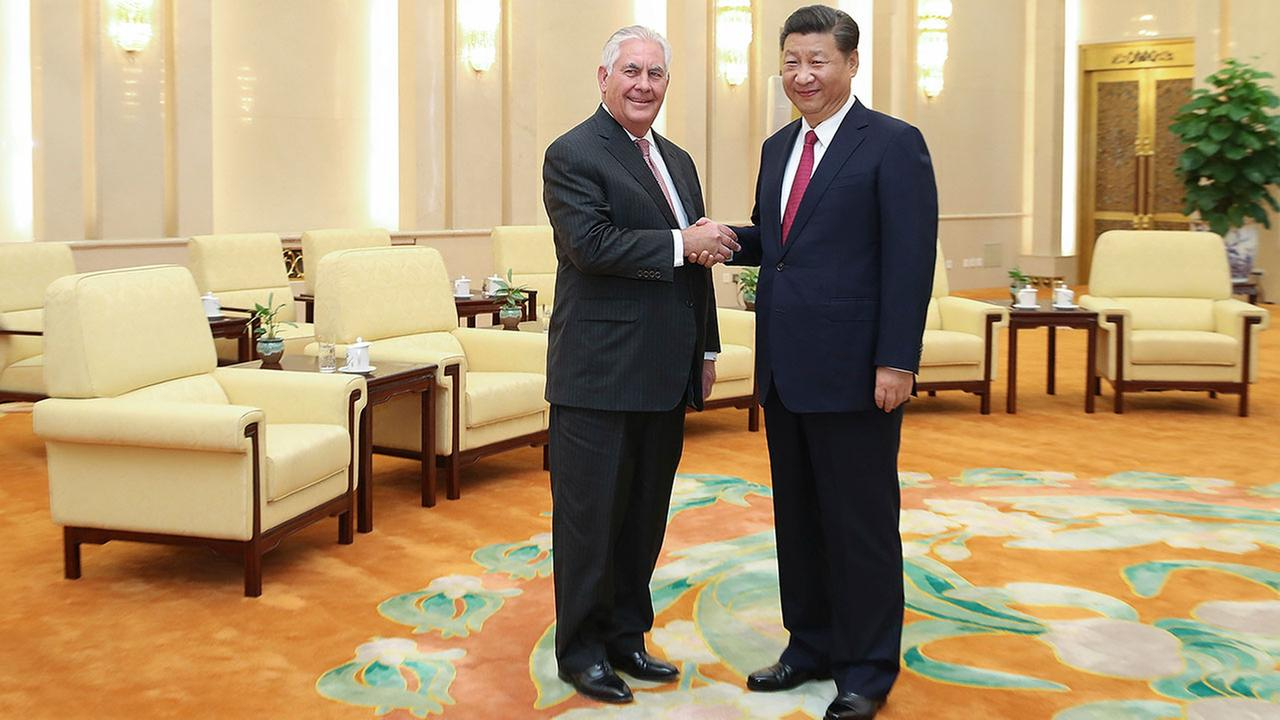 U.S. Secretary of State Rex Tillerson, left, shakes hands with Chinas President Xi Jinping, center right, at the Great Hall of the People, Saturday, Sept. 30, 2017 in Beijing.