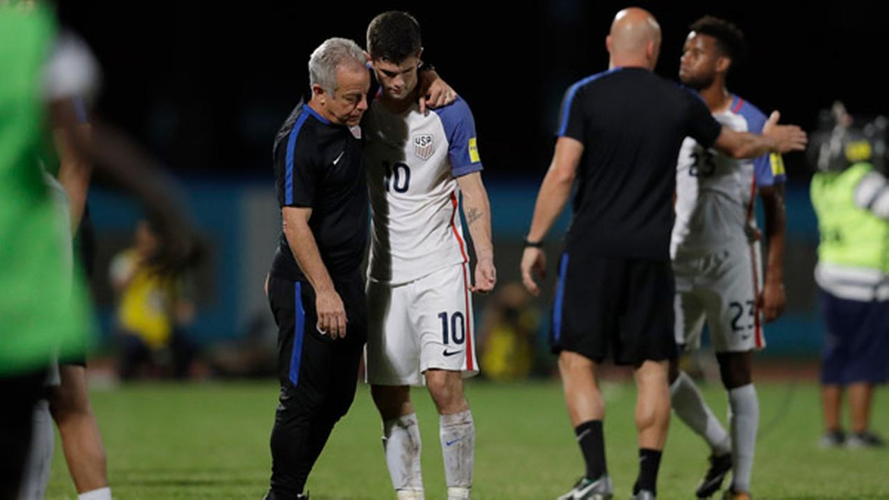 United States Christian Pulisic, (10) is comforted after losing 2-1 against Trinidad and Tobago during a 2018 World Cup qualifying soccer match  in Couva, Trinidad.