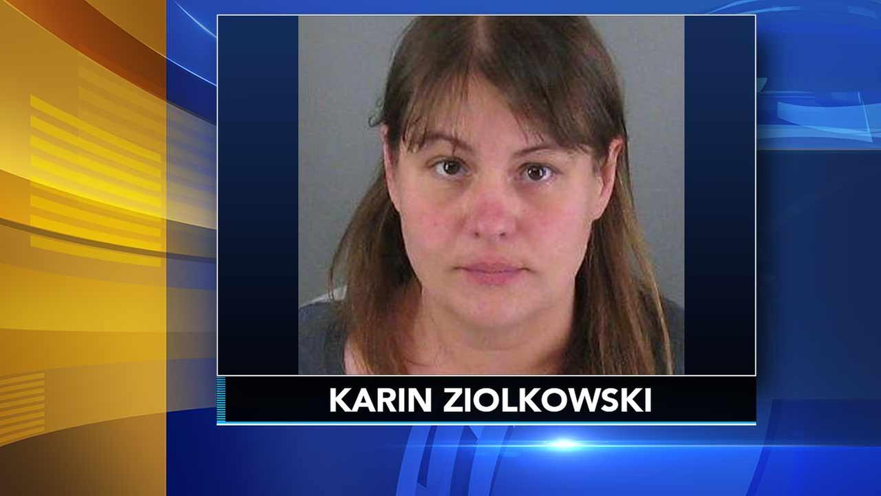 Woman accused of killing son, using tiki oil to burn home