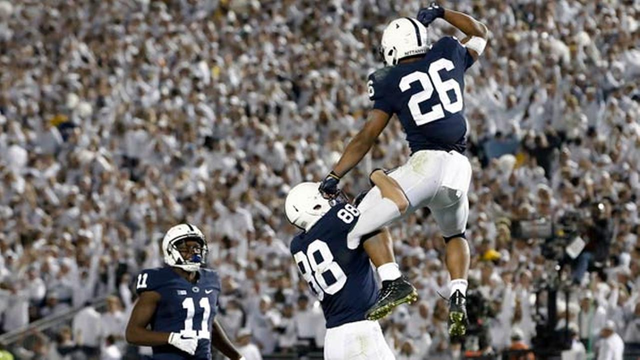 Penn States Saquon Barkley (26) celebrates with Mike Gesicki (88) after scoring a touchdown against Michigan during the second half of an NCAA college football game.