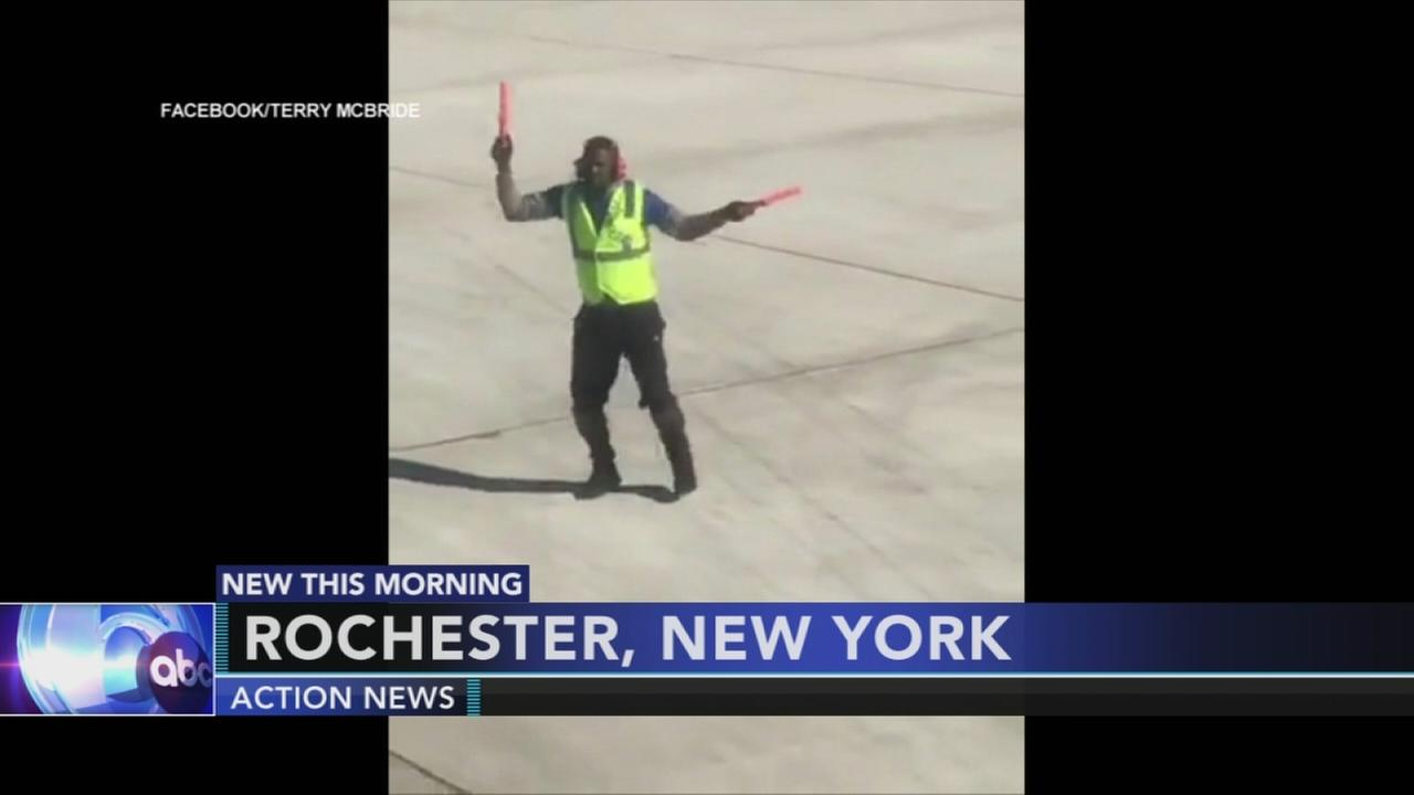 Airport worker brings smiles to passengers