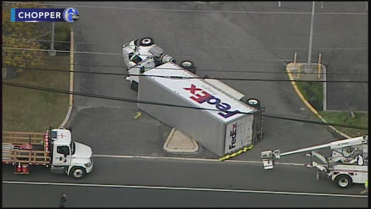 Fed Ex truck tips over in Burlington County