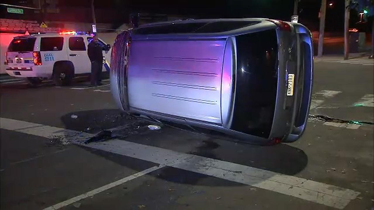 Van flips after crash in Kensington