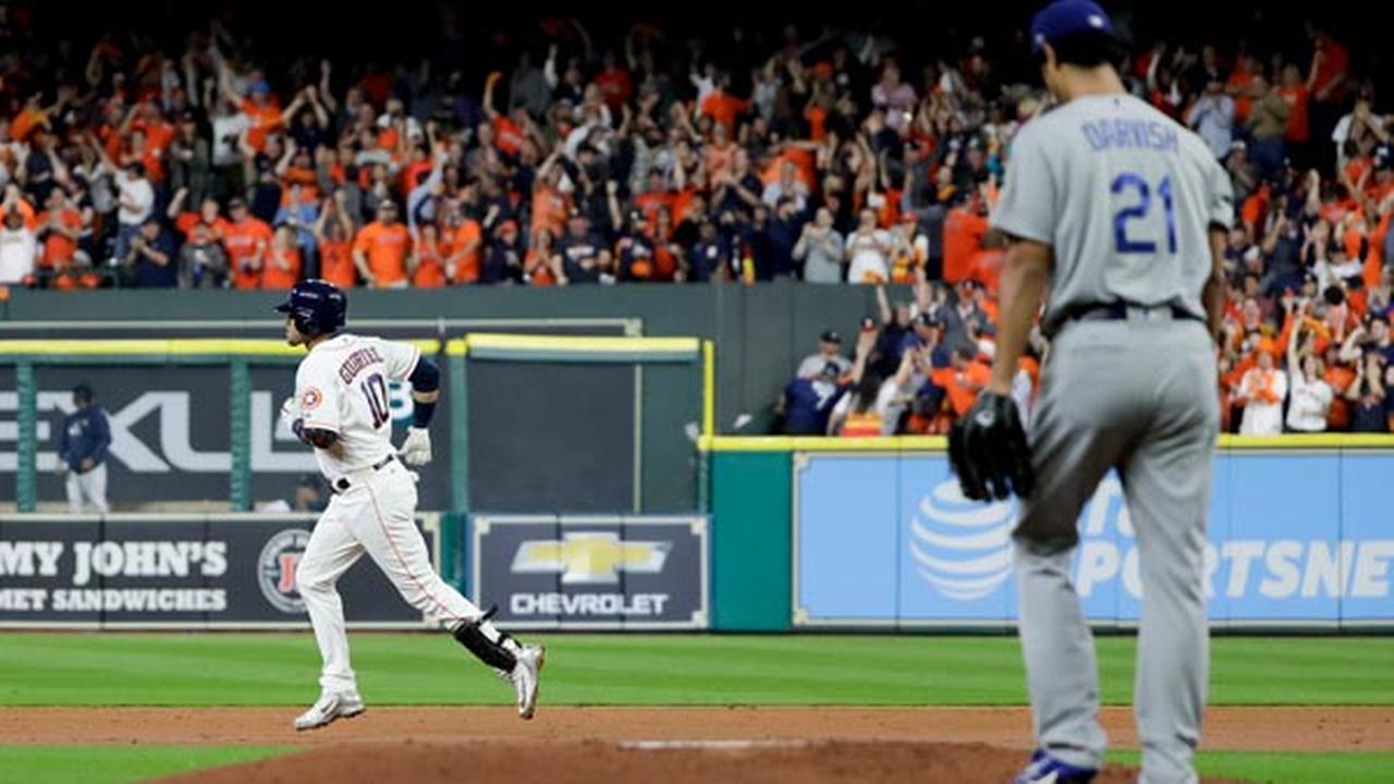 Houston Astros Yuli Gurriel celebrates his home run past Los Angeles Dodgers starting pitcher Yu Darvish, of Japan.
