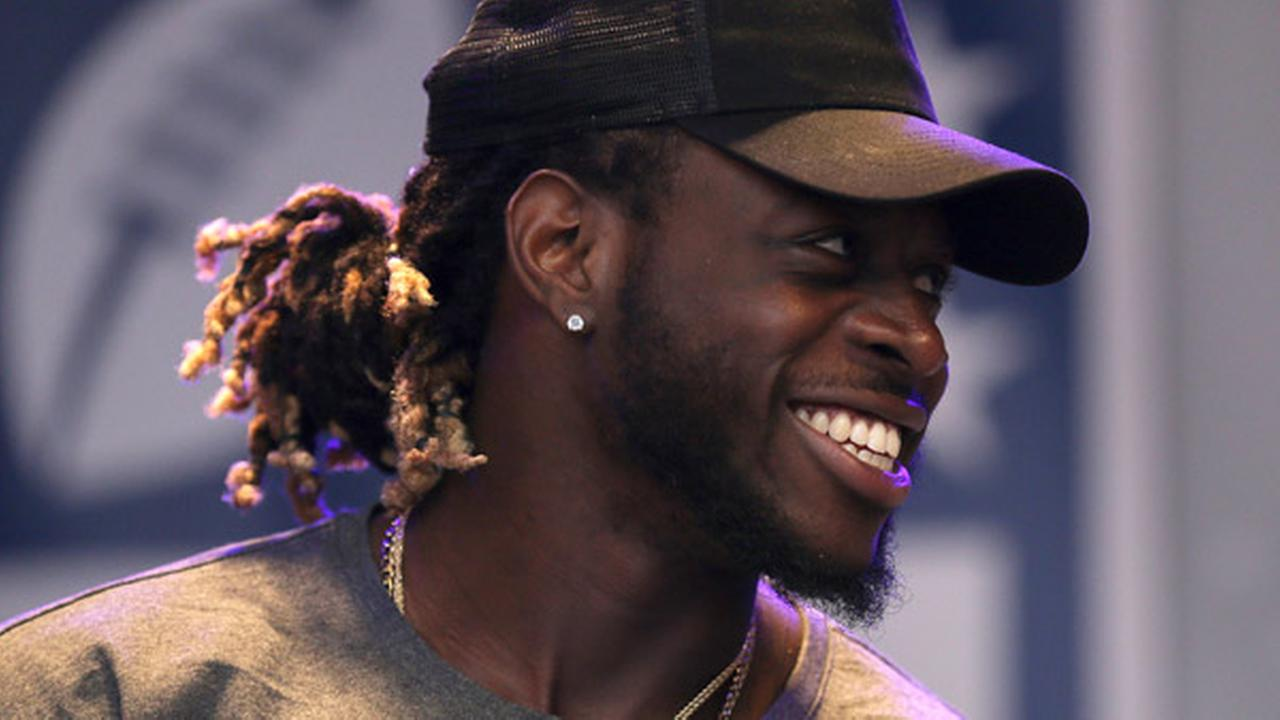 Miami Dolphins running back Jay Ajayi smiles on stage during an NFL fan rally on Regent Street, in London, Saturday Sept. 30, 2017.