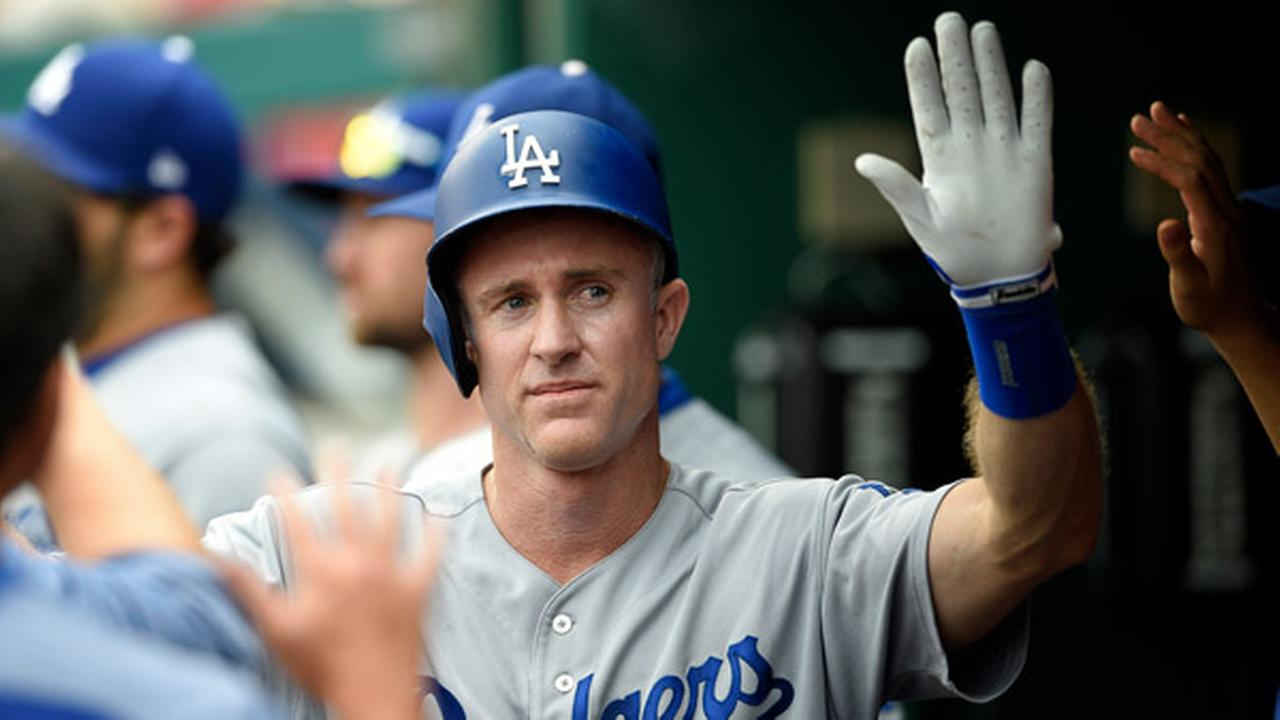 FILE: Los Angeles Dodgers Chase Utley gets high-fives in the dugout during the fifth inning of a baseball game against the Washington Nationals, Saturday, Sept. 16, 2017,