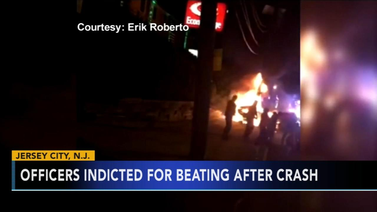 Four police officers charged after kicking burning bystander