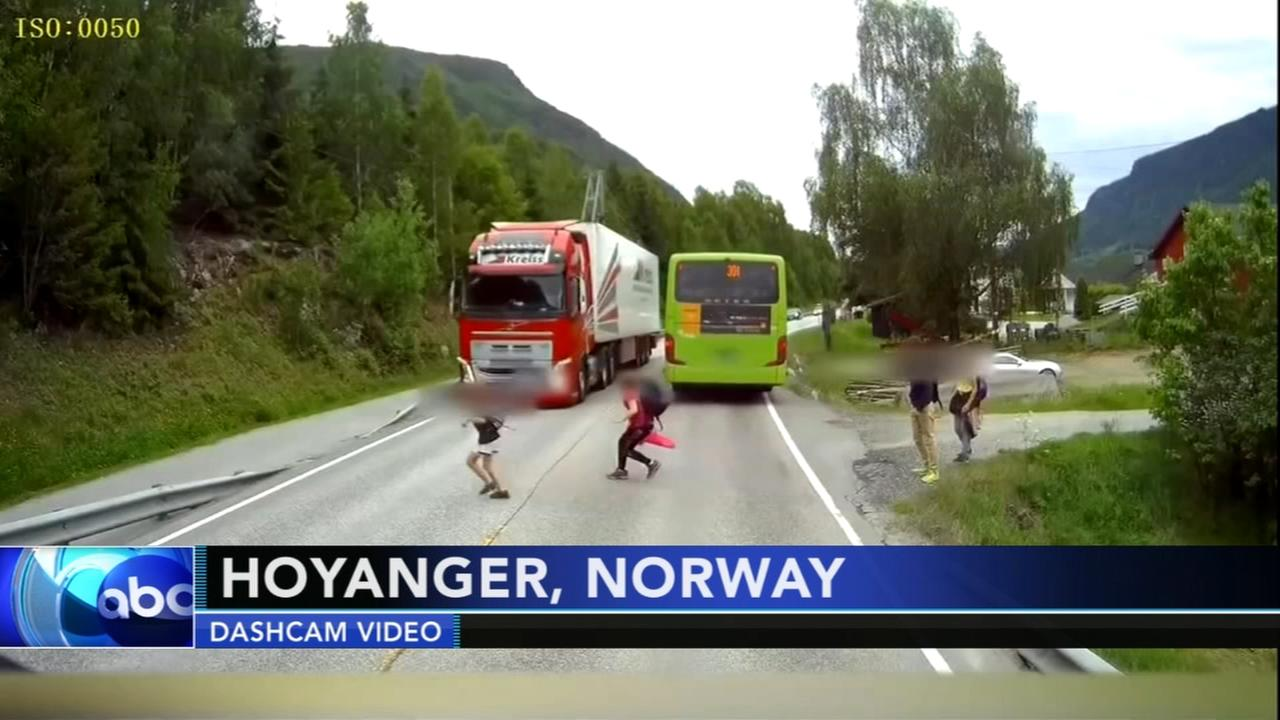 Close call as boy walks in front of bus