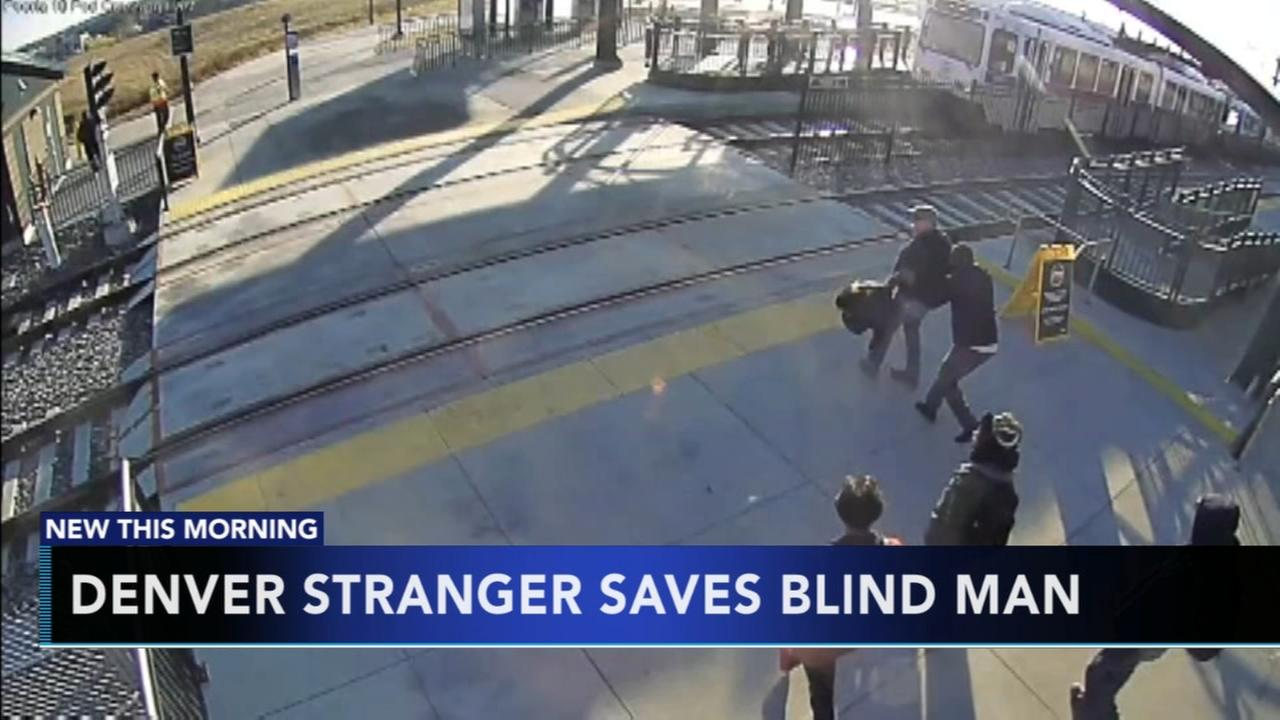 Denver stranger saves blind man from train