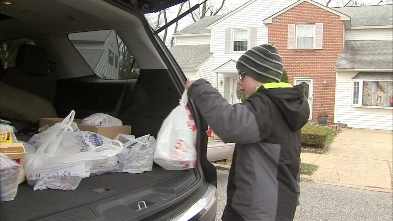 Boy Scouts pack bags for Thanksgiving in Sommerton