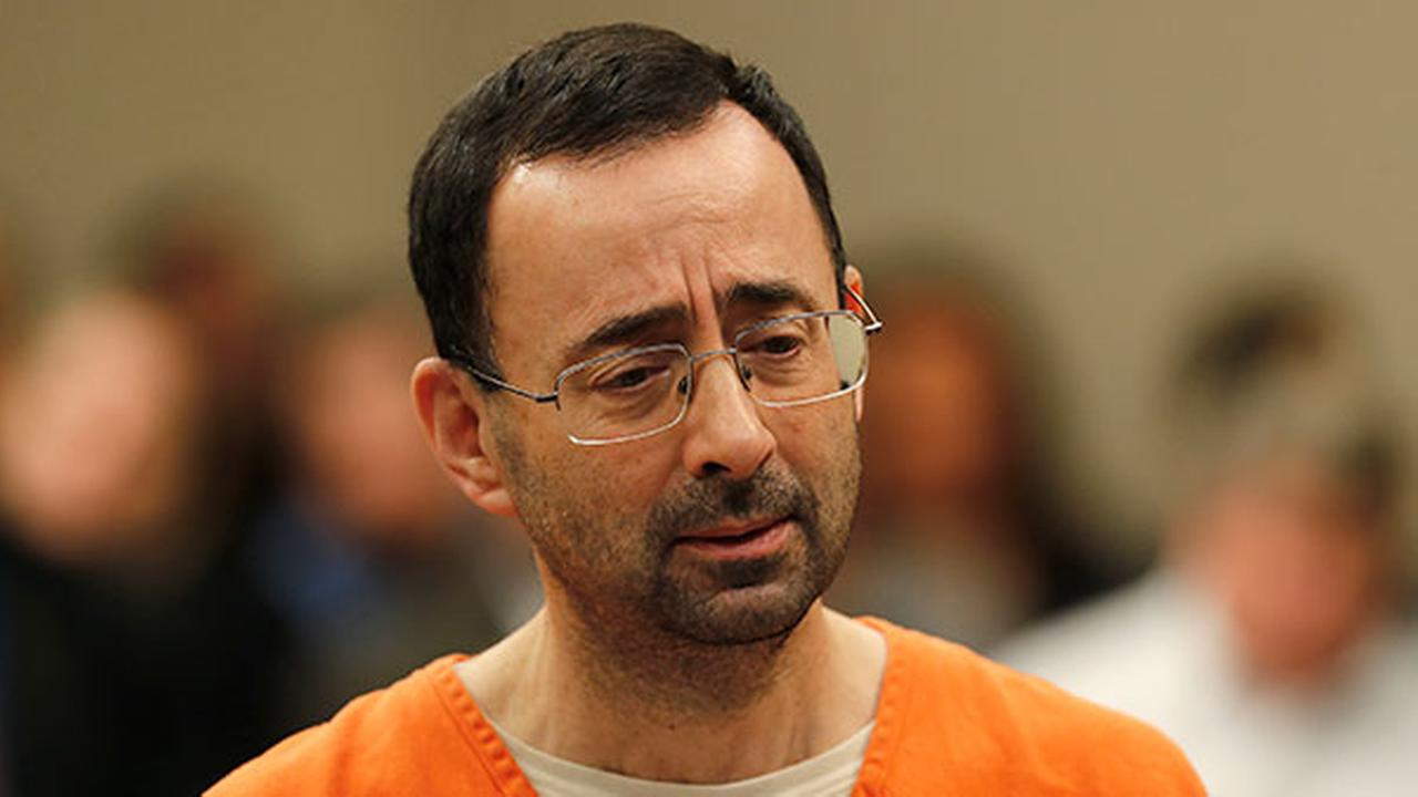 Dr. Larry Nassar, 54, appears in court for a plea hearing in Lansing, Mich., Wednesday, Nov. 22, 2017.