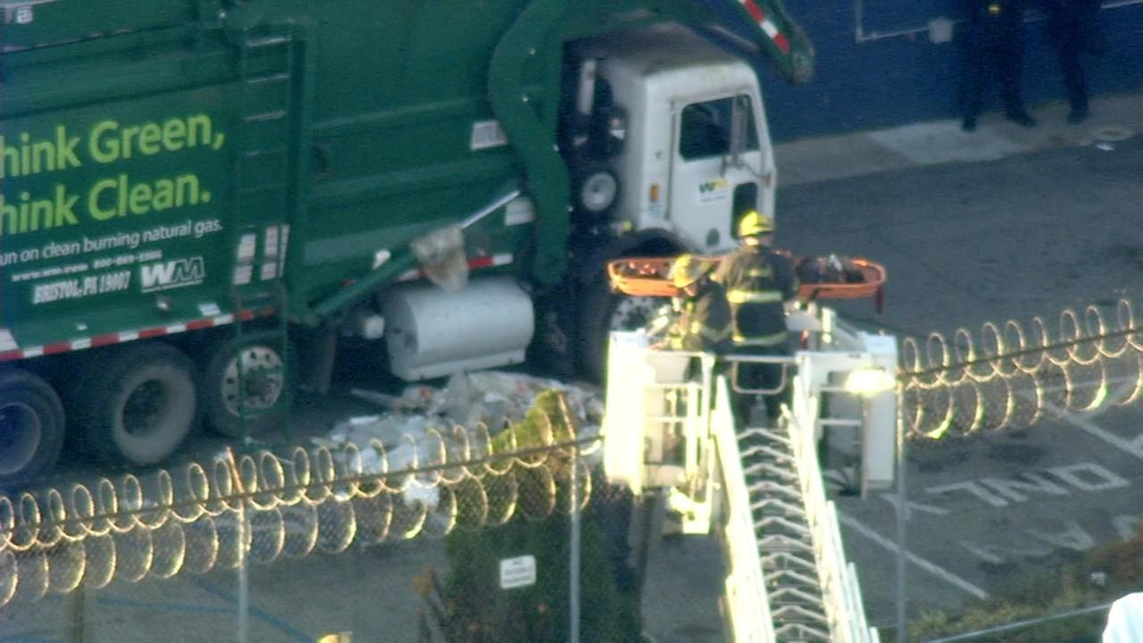 RAW VIDEO: Trash truck rescue